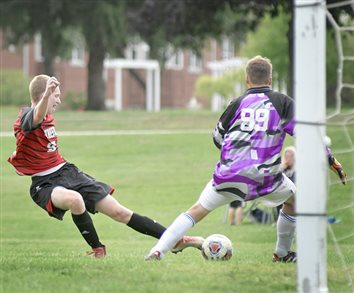 Manchester Sweeps Rival Whitko