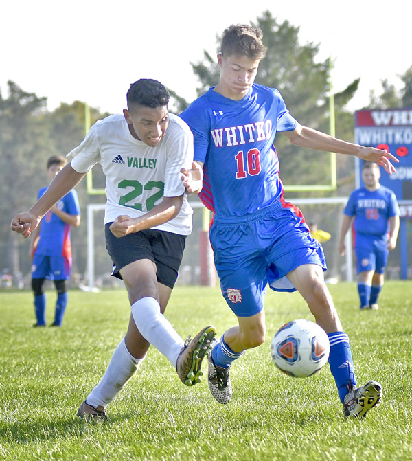 Tippecanoe Valley freshman Joel Cisneros gets off a shot-on-goal as Whitko junior Noah Dickerson defends. Photo by Gary Nieter, Times-Union