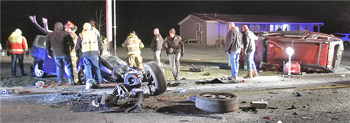 Photo by Gary?Nieter, Times-Union Medics and firefighters work to free one of the drivers involved in Thursday night's two-vehicle accident on Ind. 19, south of CR 800 S.