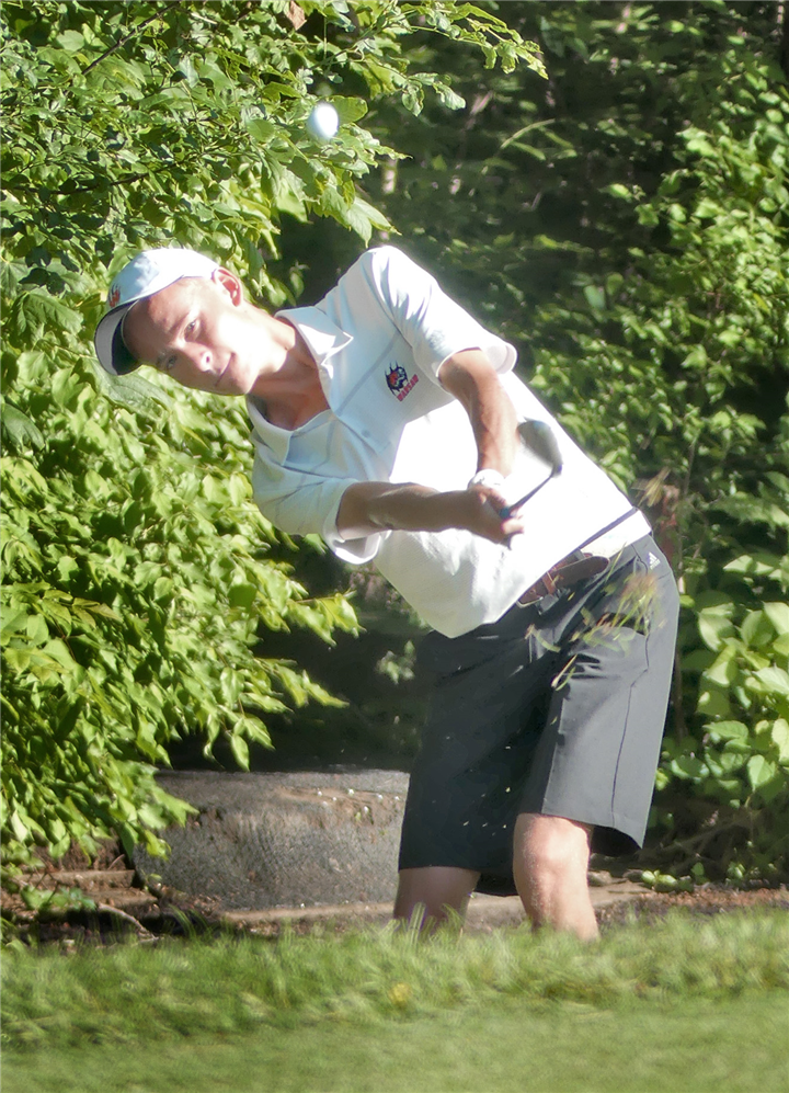 Photo by Gary Nieter, Times-Union  Warsaw sophomore Tucker Carlile watches the flight of his ball while hitting onto the green.