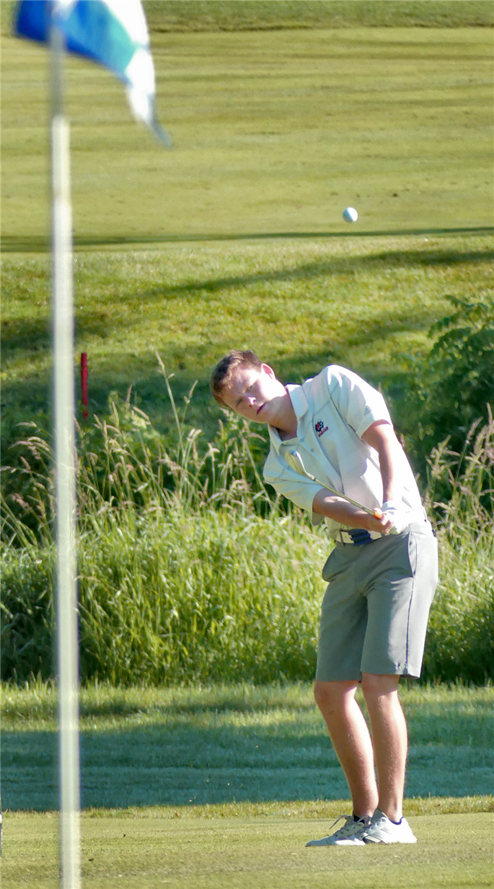 Photo by Gary Nieter, Times-Union  Junior Zach LaLonde takes aim at the pin on the tenth green during Tuesday morning's round.