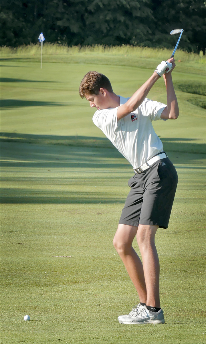 Photo by Gary Nieter, Times-Union  With his target in the distance, Warsaw freshman Jack Yeager hits his second shot on the tenth hole.