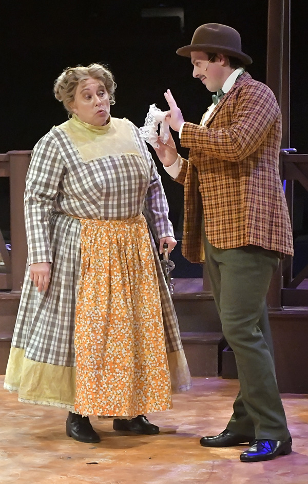 "Ali Hakim (Logan Foster, R) tries to peddle his wares to Aunt Eller (Kathy Hawkins) in ""Oklahoma!"" Photo by Gary Nieter, Times-Union."