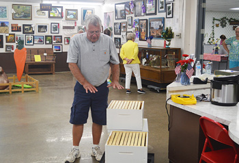 Bob Haney, of Warsaw, shows off one of his hives during a demonstration talking about beekeeping Wednesday at the Kosciusko County Fair. Photo by Jacki Gorski