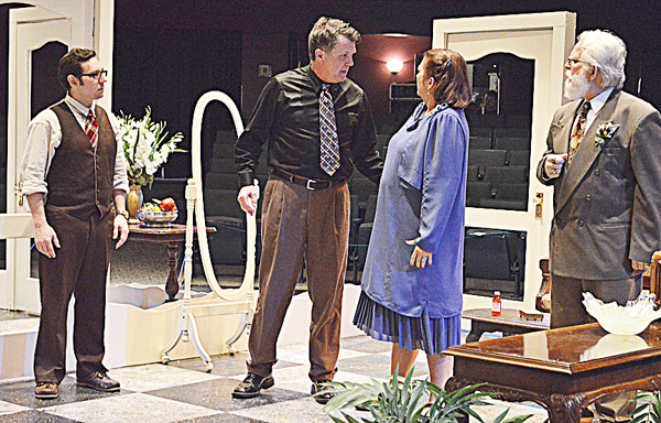 "Max (Justin Weaver, L) and Saunders (Gerald Cox, R) listen as Tito (Tim Davis) and his wife, Maria (Cindy Nash), bicker during rehearsals of Center Street Community Theater's production of ""Lend Me A Tenor."" Photo by David Slone, Times-Union."
