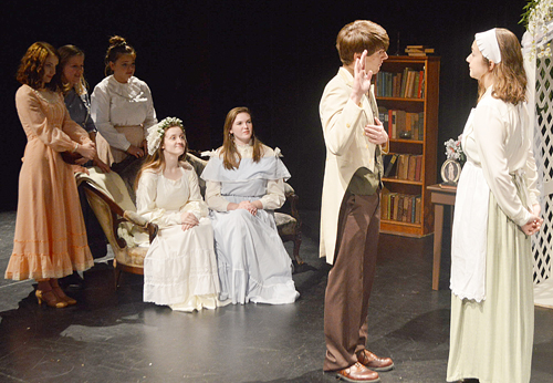 "Laurie (Luke Howard, second from right) swears to Hannah (Michelle Apeland) that he'll never cause such a disturbance as he just did, while the March women look on in ""Good Wives."" Photo by David Slone"
