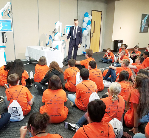 Dr. Chris Cannova from Washington, D.C., shows Edgewood Middle School students the ROSA Knee Robot during their DiscoverME Field Trip at Zimmer Biomet. Photo Provided