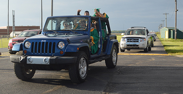 Tippecanoe Valley High School seniors drive out of the TVHS parking lot onto Ind. 19 to start the senior parade Friday to celebrate graduation. Photo by Jackie Gorski, Times-Union.