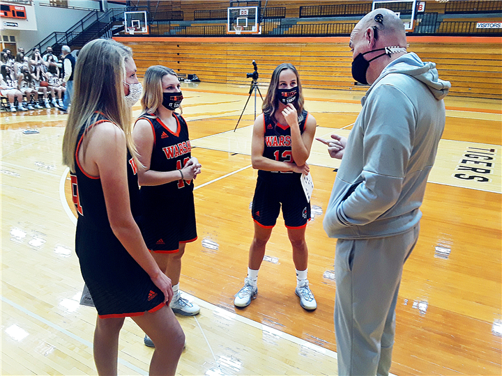 Photo by Drew Fritz, Times-Union Warsaw Girls Basketball Head Coach Lenny Krebs has a chat with Lady Tiger seniors (L-R) Audrey Grimm, Kensie Ryman and Kendall Wayne during Monday's media day activities at the school's Tiger Den. Watch for the Warsaw Lady Tigers 2020-21 season preview in this Friday's Times-Union.