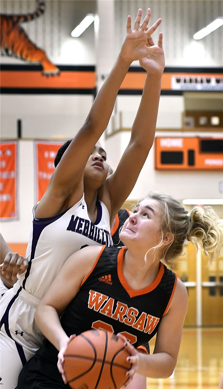 Sophomore Lauren Grose waits for an opportune time to go up with her shot during the first quarter of Saturday morning's game against Merrillville.