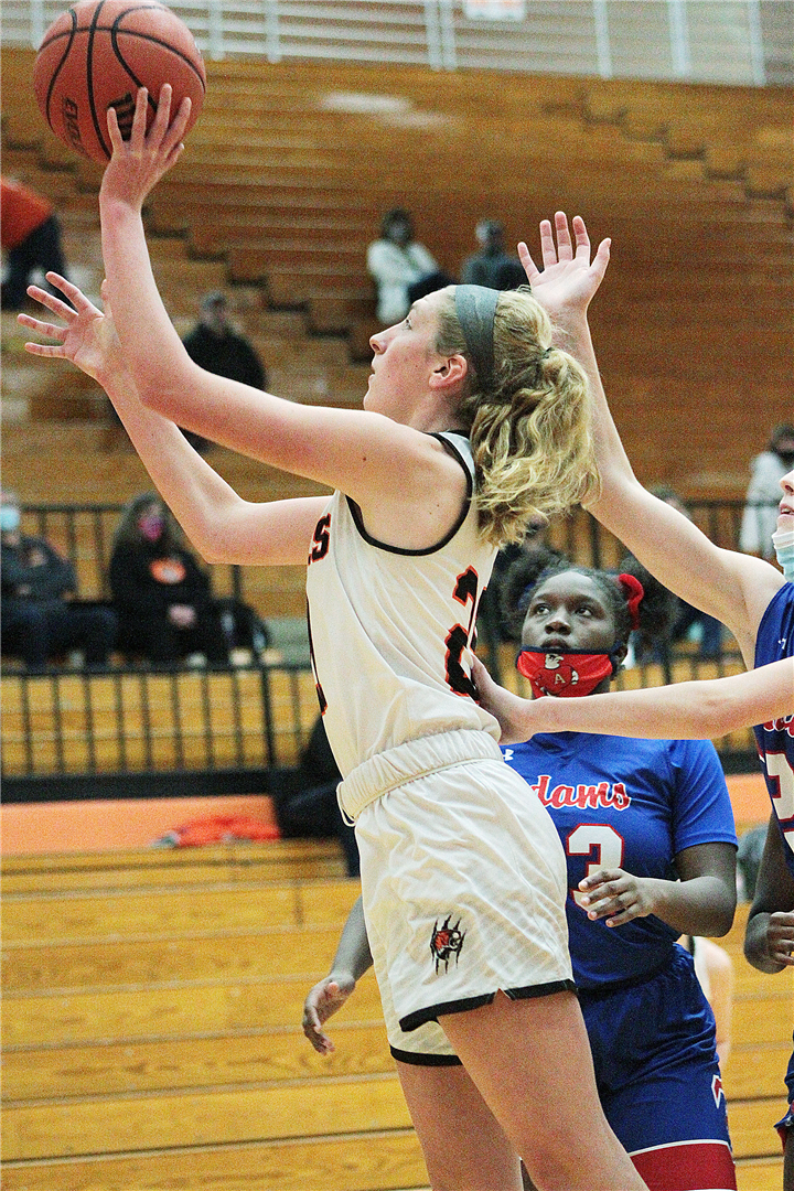 Photo by Drew Fritz, Times-Union Senior Audrey Grimm puts up a shot and scores against Adams.