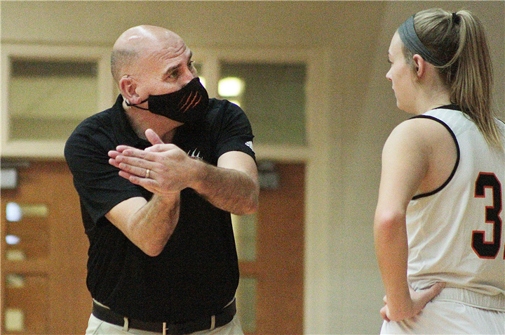 Photo by Drew Fritz/Times-Union Head coach Lenny Krebs gives some individual instruction during the team's evening game on Saturday. The win was his 50th as head coach of the Lady Tigers.
