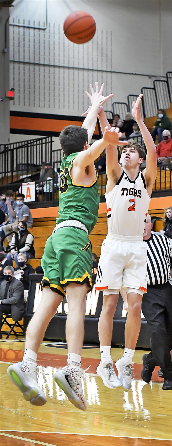 Photo by Gary Nieter/Times-Union Warsaw sophomore Jaxon Gould launches a three-pointer during the first quarter of Friday night's home game against Northridge. Gould notched a double-double with 17 points and 11 rebounds.