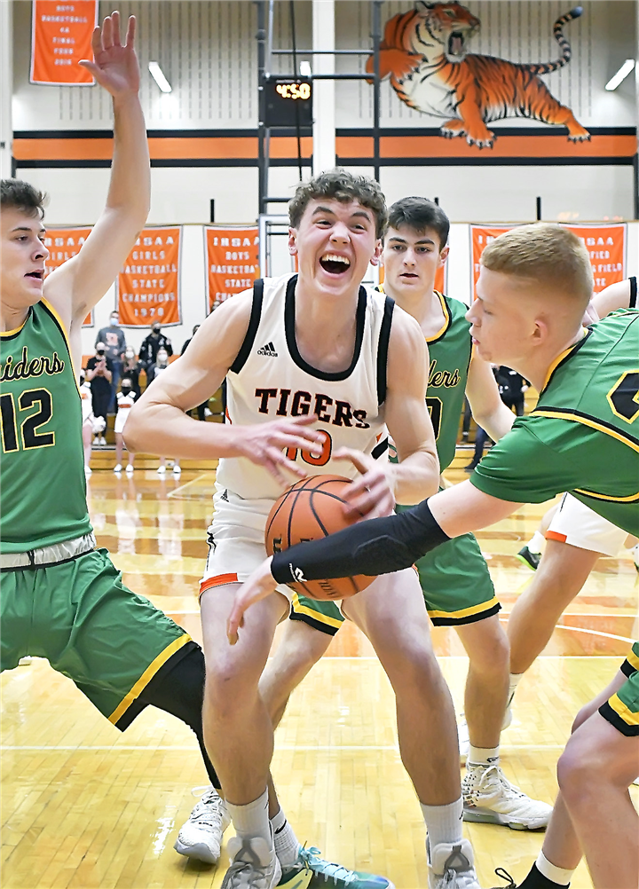 Photo by Gary Nieter/Times-Union Senior Ben Bergen of Warsaw finds himself in the midst of the Northridge defense while working under the basket. Bergen was perfect from the floor with a trio of three-pointers and finished with 15 points.
