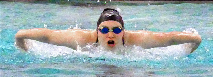 Photos by Gary Nieter, Times-Union Senior Maddy Morgan of Warsaw stretches out while swimming the 100-yard butterfly.