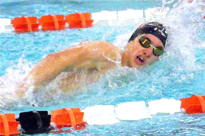 Photos by Gary Nieter, Times-Union Senior Michael Ray grabs a breath of air while swimming the 100-yard freestyle.