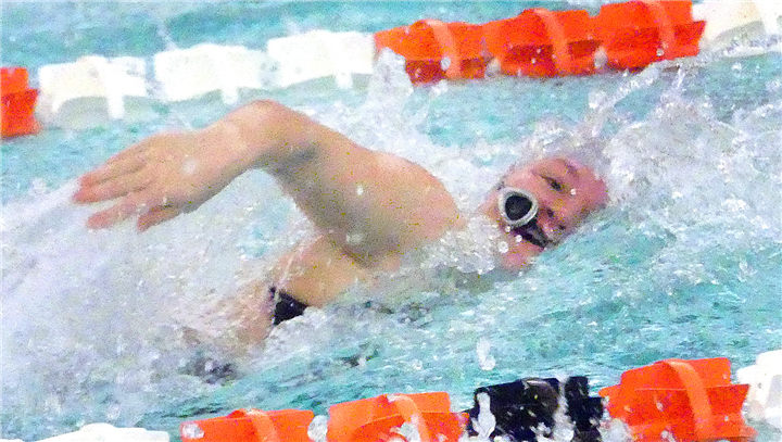 Photos by Gary Nieter, Times-Union Senior Lillian Boston of Warsaw appears to be outswimming her goggles during the 50-yard freestyle.