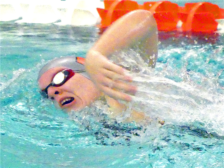 Photos by Gary Nieter, Times-Union Water streams from the fingers of Warsaw junior Rachel Doyle as she swims the 500-yard freestyle.