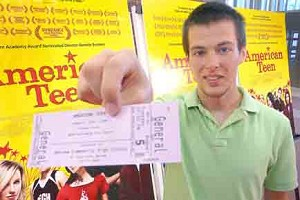 'American Teen' star Jake Tusing holds out his ticket for the movie. Photo by Gary Nieter, Times-Union