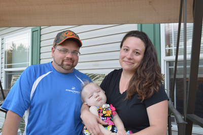 Pictured (L to R) are Terry, Ali and Mandi Hygema at their home in Leesburg. Ali marked her first birthday in July. Doctors told her parents when she was born that she was not expected to live. Photo by Jennifer Peryam, Times-Union