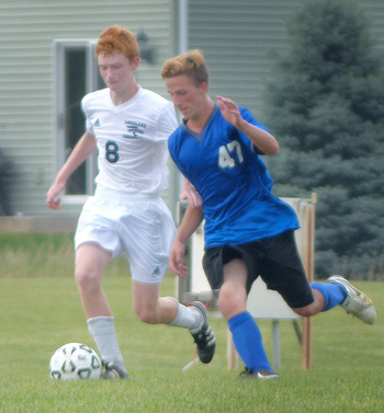Lakeland Christian freshman Garrett McCoomb (L) and Whitko senior Johannes Bingham battle for the ball during Saturday's match in Winona Lake. Photo by Gary Nieter, Times-Union